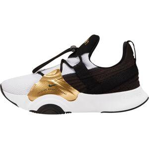 NIKE Sportovní boty  bílá / černá / zlatá